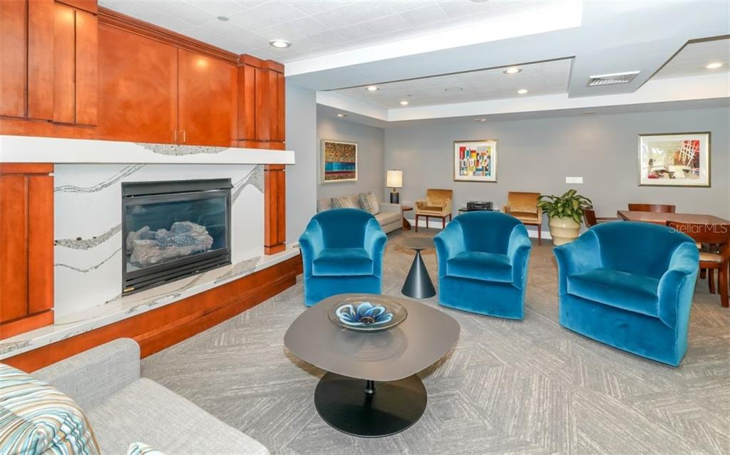A fireplace to warm up the social room - Condo for sale at 100 Central Ave #A401, Sarasota, FL 34236 - MLS Number is A4463296