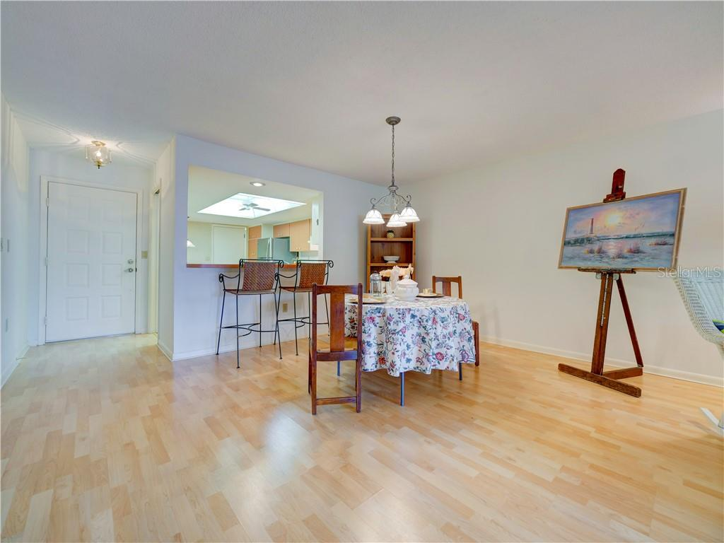 Dining area looking towards kitchen with breakfast bar - Villa for sale at 4335 Rum Cay Cir, Sarasota, FL 34233 - MLS Number is A4463762