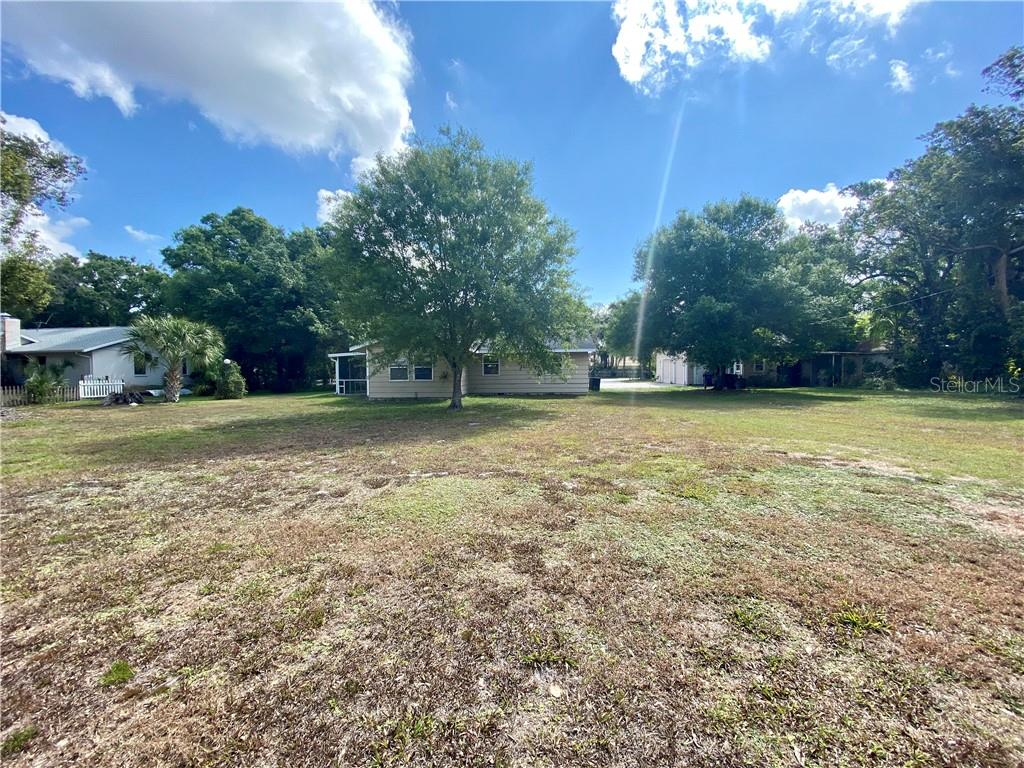 Back yard, detached garage to the right. - Single Family Home for sale at 4300 Eastern Pkwy, Sarasota, FL 34233 - MLS Number is A4464200