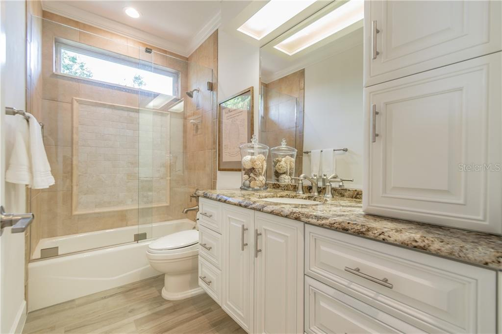 Hallway Bath across from Bedroom 3 - Single Family Home for sale at 1418 John Ringling Pkwy, Sarasota, FL 34236 - MLS Number is A4467093