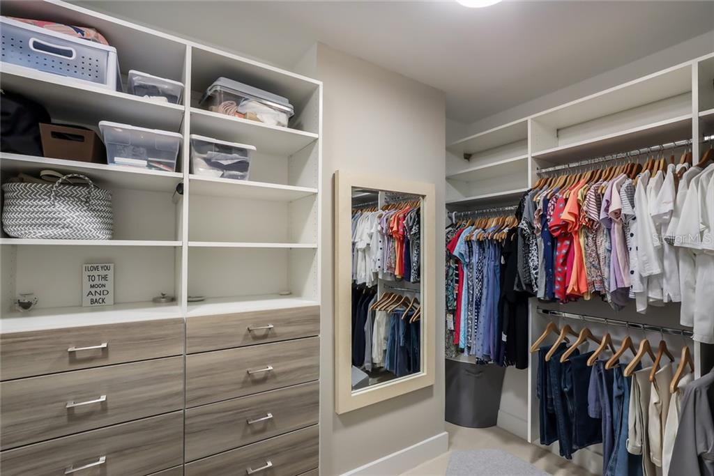 The large master closet has plenty of space and the built-in shelving and drawers give supreme organization and efficiency. - Condo for sale at 1155 N Gulfstream Ave #1404, Sarasota, FL 34236 - MLS Number is A4467921