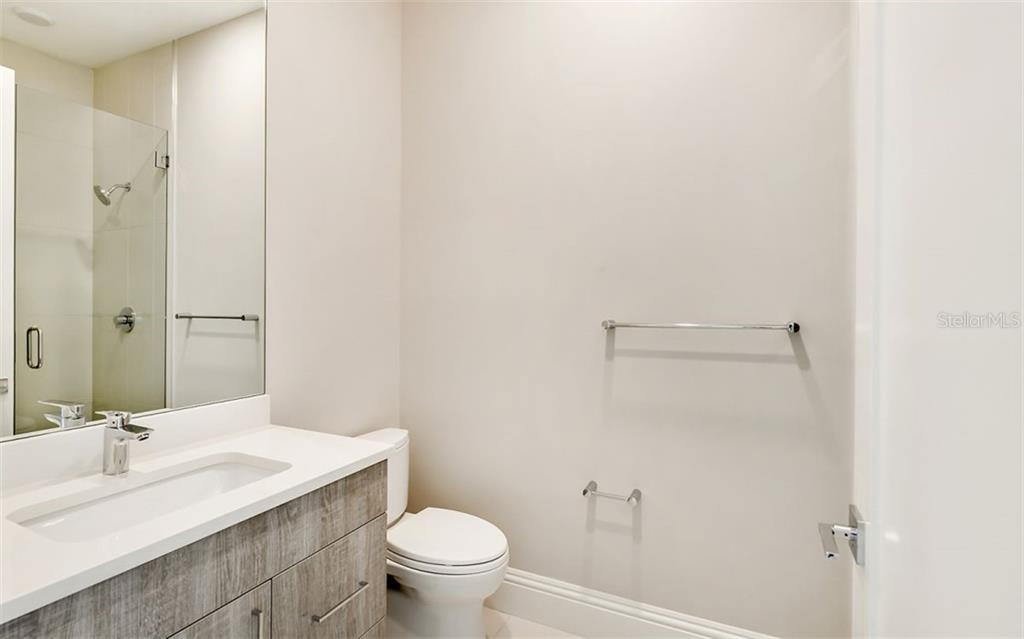 Each bedroom is en suite,  with each bath providing contemporary fixtures and sleek lines. - Condo for sale at 609 Golden Gate Pt #201, Sarasota, FL 34236 - MLS Number is A4468917