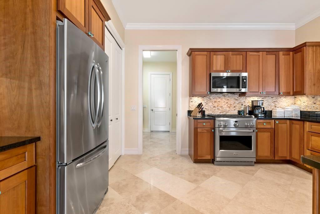 Kitchen with high end stainless appliances - Single Family Home for sale at 605 N Point Dr, Holmes Beach, FL 34217 - MLS Number is A4469001
