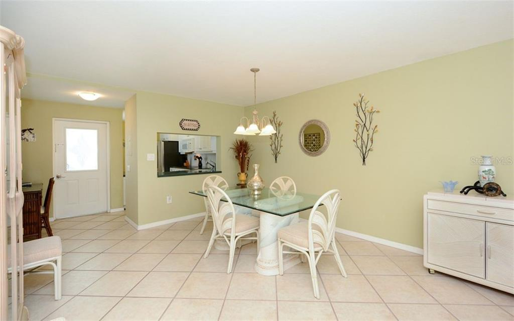 Dining room. - Condo for sale at 1770 Benjamin Franklin Dr #706, Sarasota, FL 34236 - MLS Number is A4469463