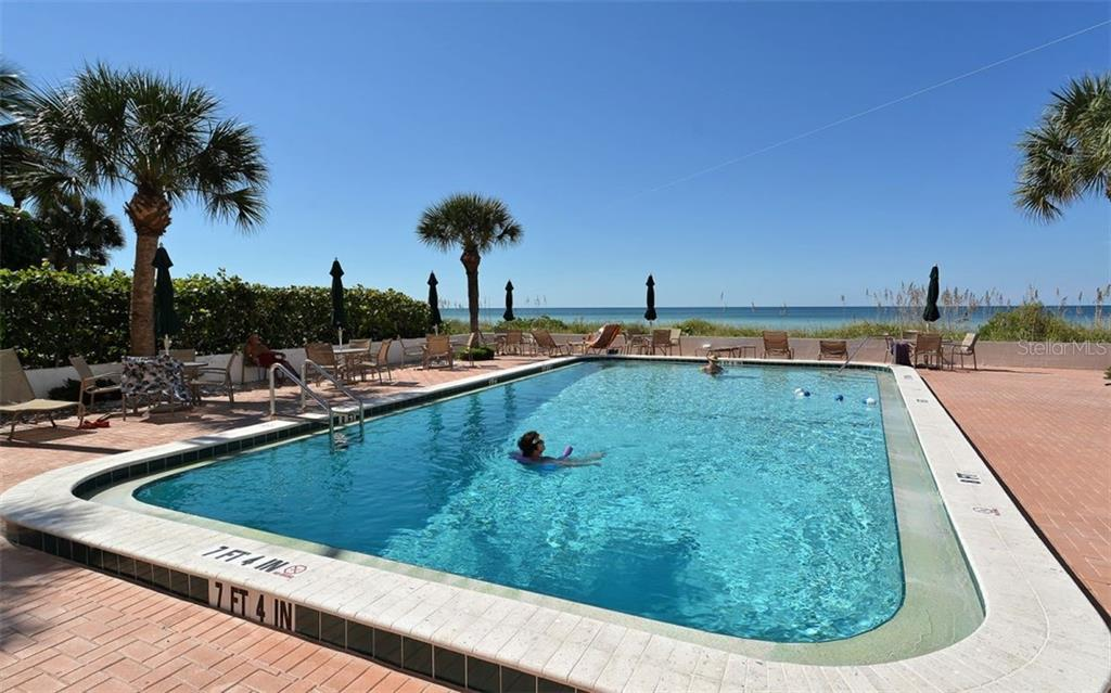 Swim while you enjoy views of the gulf. - Condo for sale at 1770 Benjamin Franklin Dr #706, Sarasota, FL 34236 - MLS Number is A4469463