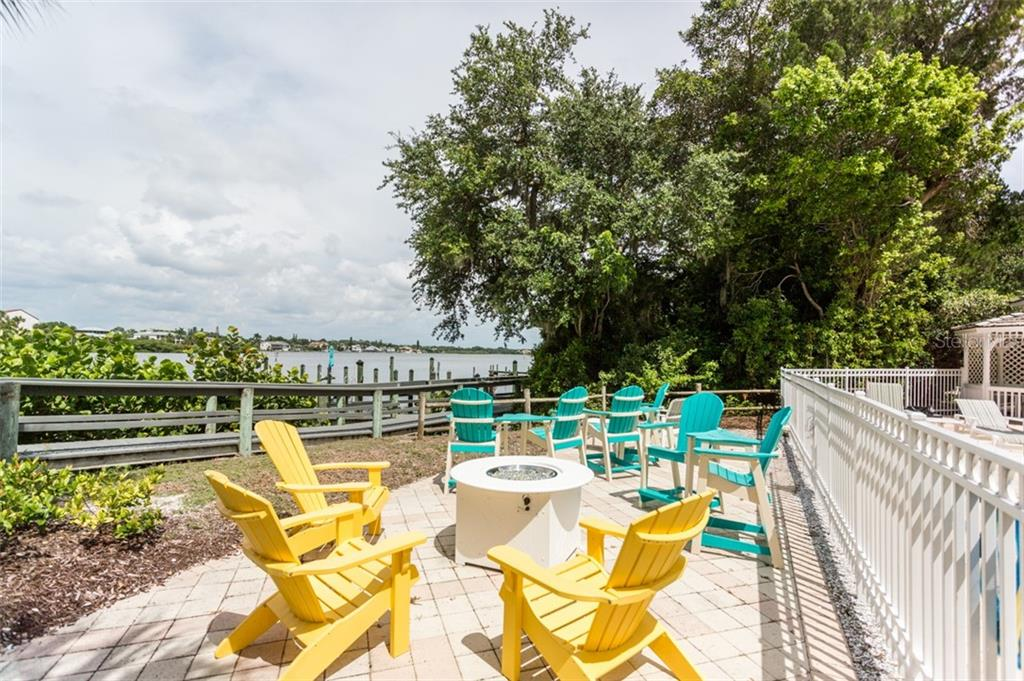 Fire pit next to pool overlooking the Intracoastal Waterway - Condo for sale at 1308 Old Stickney Point Rd #W24, Sarasota, FL 34242 - MLS Number is A4471155