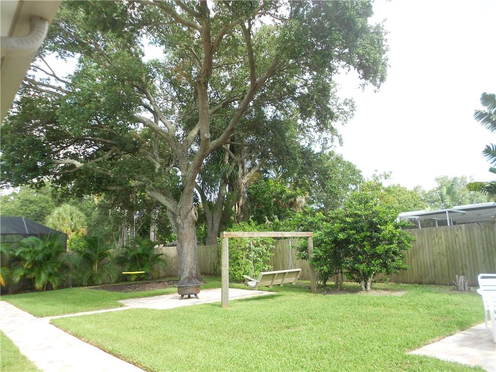 Privacy Fenced Back Yard with 2 Swings - Single Family Home for sale at 5326 Colewood Pl, Sarasota, FL 34232 - MLS Number is A4471495