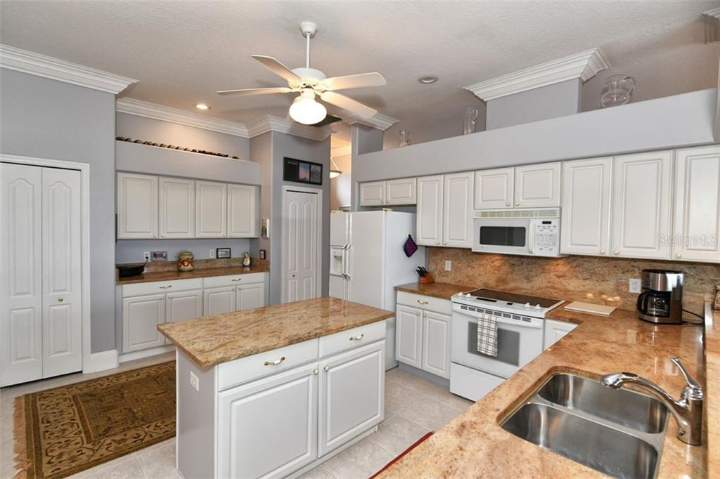 Granite counter tops, raised panel cabinet doors, center island, two pantries and a lighted buffer area with extra storage cabinets. - Villa for sale at 4590 Samoset Dr, Sarasota, FL 34241 - MLS Number is A4471881