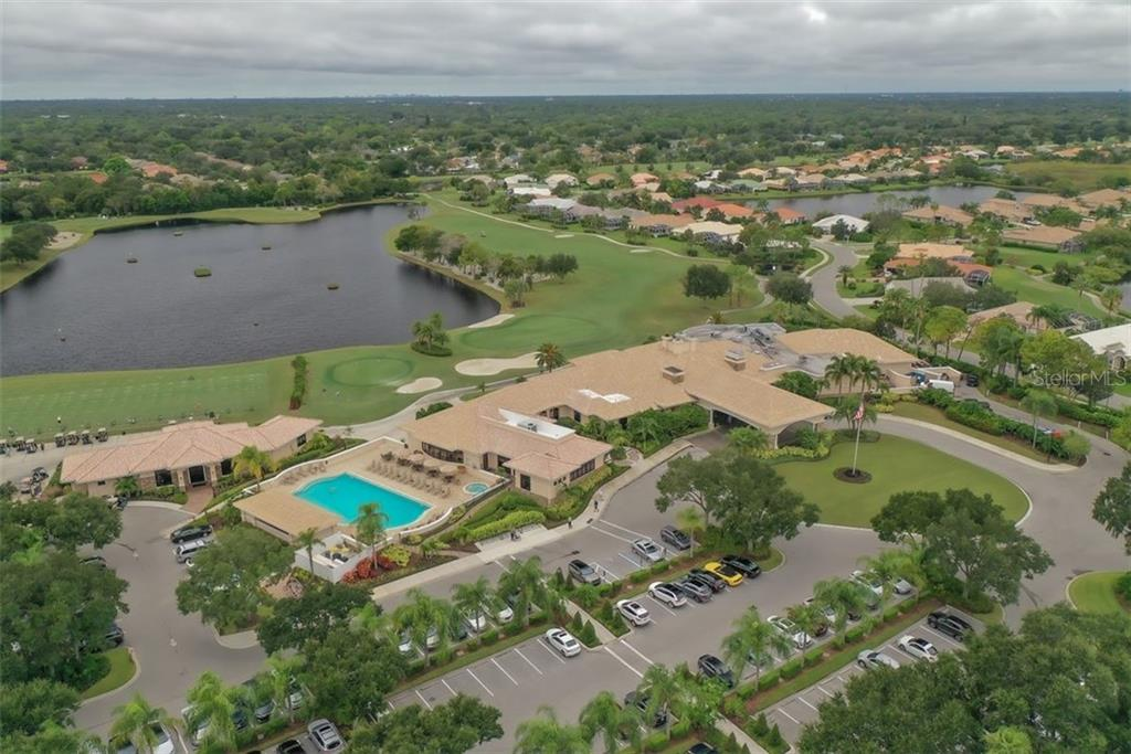 Bird's eye view of the Club House, main pool, the Pro Shop and the 18th hole to the club house. - Villa for sale at 4590 Samoset Dr, Sarasota, FL 34241 - MLS Number is A4471881