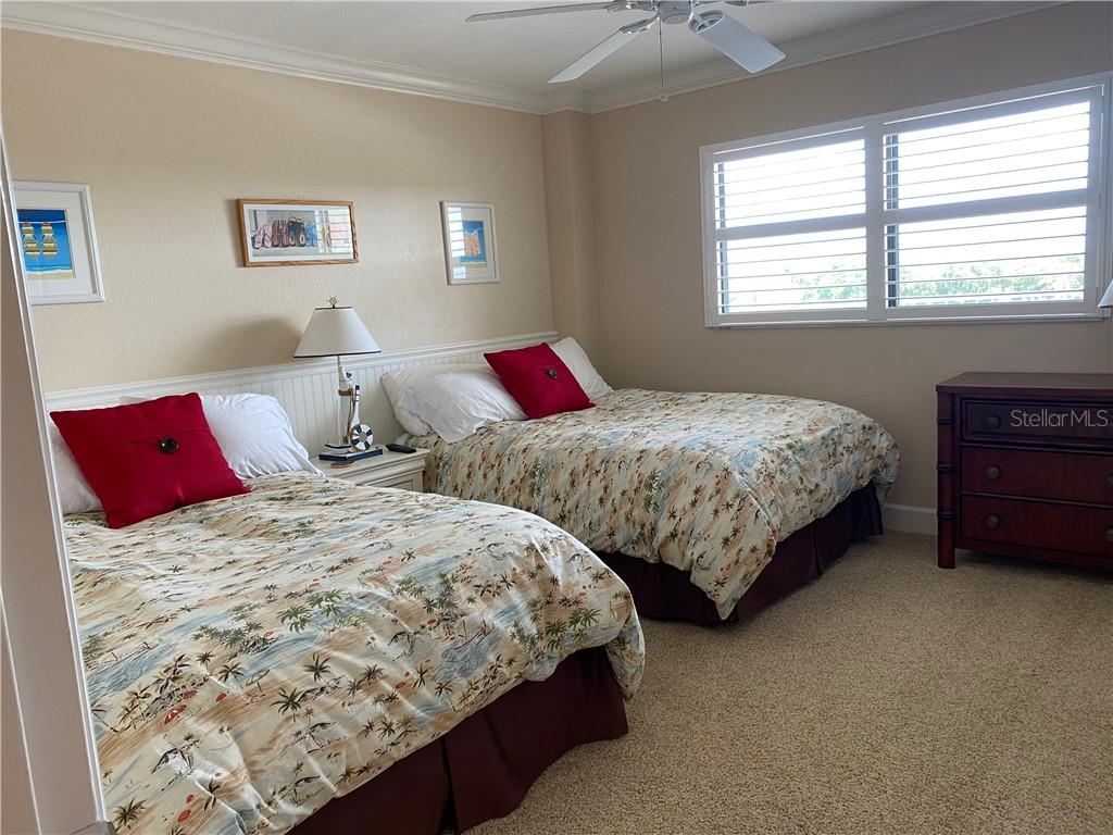 The guest bedroom has 2 full size beds with ample closet space. - Condo for sale at 5770 Midnight Pass Rd #509c, Sarasota, FL 34242 - MLS Number is A4472645