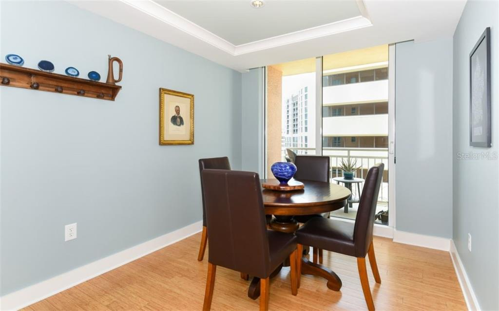 Dining room with its own terrace - Condo for sale at 1350 Main St #1001, Sarasota, FL 34236 - MLS Number is A4472708