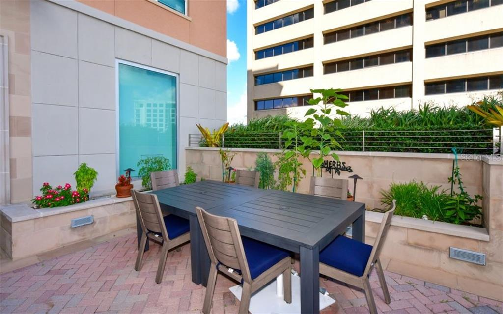 Eating area and herb garden - Condo for sale at 1350 Main St #1001, Sarasota, FL 34236 - MLS Number is A4472708