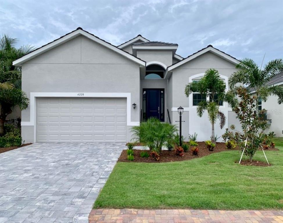Quick Move-In Grenada floor plan by Medallion Home in the gated community of Legends Bay - Single Family Home for sale at 6228 Champions Row St, Bradenton, FL 34210 - MLS Number is A4473913