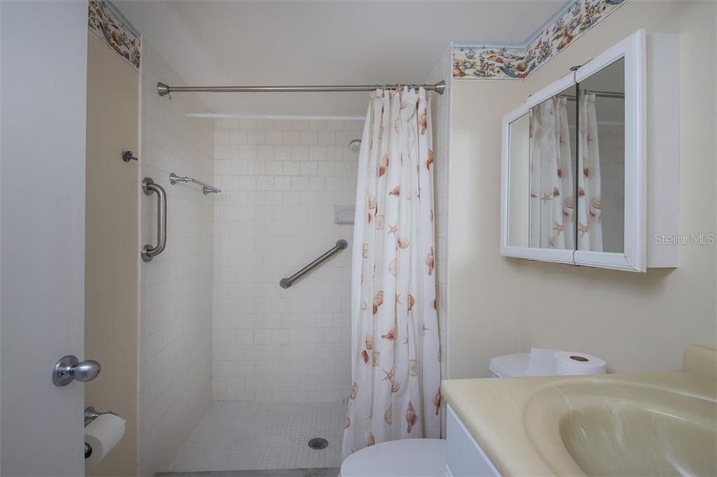 2nd bath also with ergonomic height vanity, and walk-in shower.  Note grab bars. - Condo for sale at 1330 Glen Oaks Dr E #171d, Sarasota, FL 34232 - MLS Number is A4473999