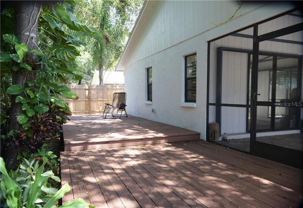 Large wood deck that runs the length of the house. - Single Family Home for sale at 3921 Warren St, Sarasota, FL 34233 - MLS Number is A4474011