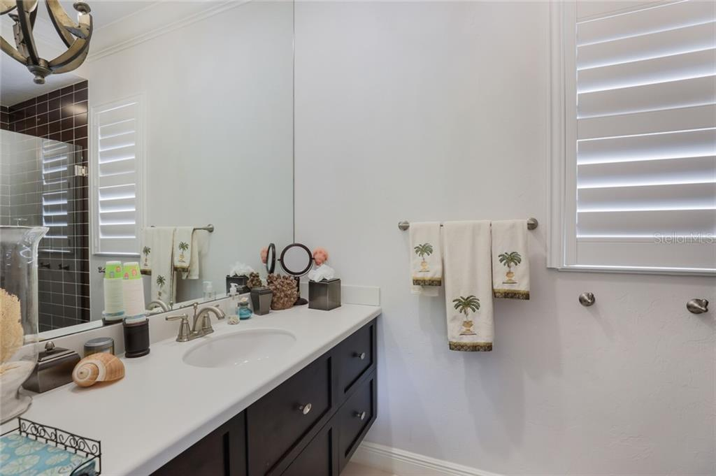 4th bedroom bath - Single Family Home for sale at 1800 Loma Linda St, Sarasota, FL 34239 - MLS Number is A4474193
