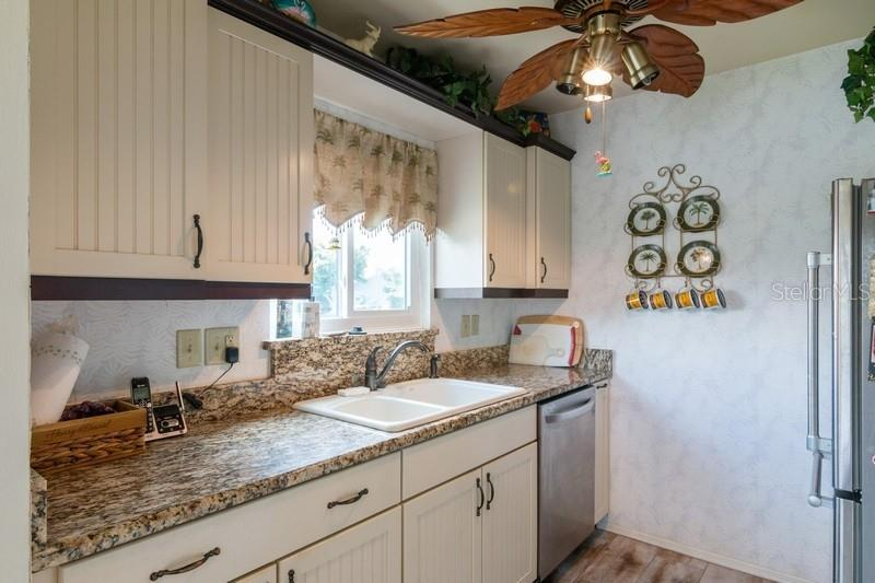 Kitchen with window and long lake view. - Condo for sale at 977 Sandpiper Cir #977, Bradenton, FL 34209 - MLS Number is A4474554