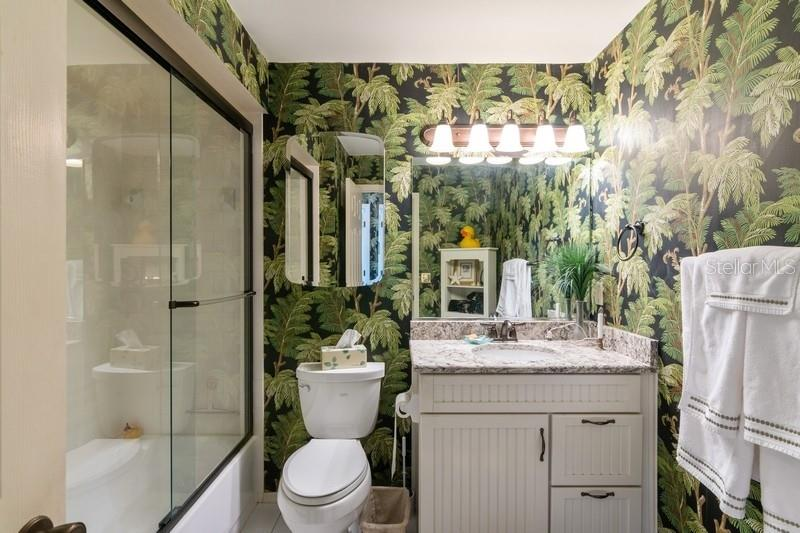 Updated Guest Bathroom with tub and shower. - Condo for sale at 977 Sandpiper Cir #977, Bradenton, FL 34209 - MLS Number is A4474554