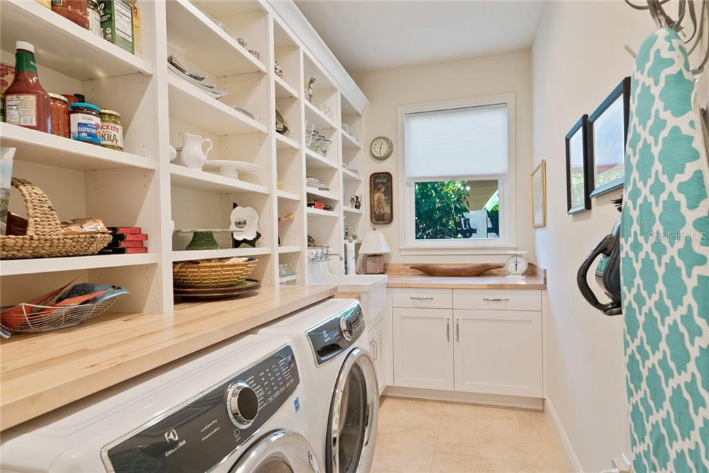 A laundry room to envy with all new cabinetry and opened shelving and new additional lighting - Single Family Home for sale at 1907 Clematis St, Sarasota, FL 34239 - MLS Number is A4474600