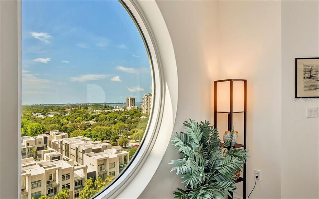 View of the city and bay from the living room window - Condo for sale at 1771 Ringling Blvd #1110, Sarasota, FL 34236 - MLS Number is A4474683