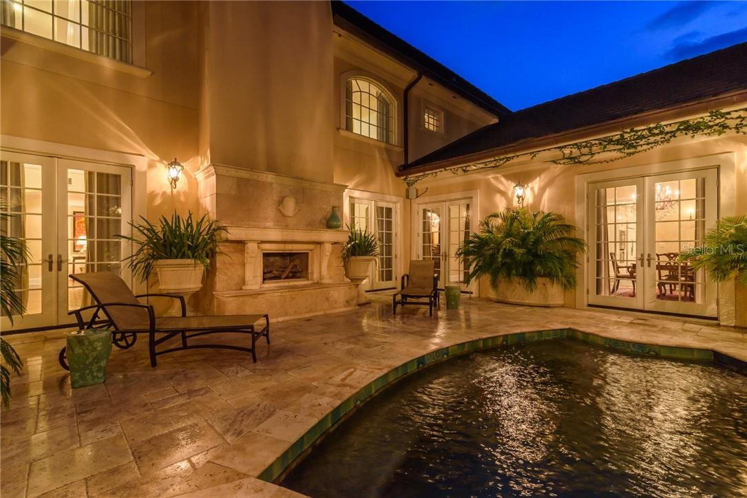 On a cool evening, enjoy a glass of brandy, while seated next to the blue pool and crackling fire! - Single Family Home for sale at 1807 Oleander St, Sarasota, FL 34239 - MLS Number is A4475067