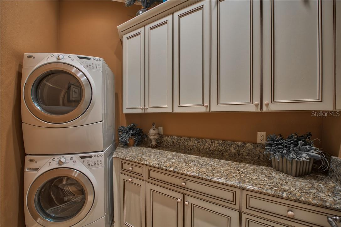 Master Closets include a Laundry Closet with Washer & Dryer - Single Family Home for sale at 8499 Lindrick Ln, Bradenton, FL 34202 - MLS Number is A4475594