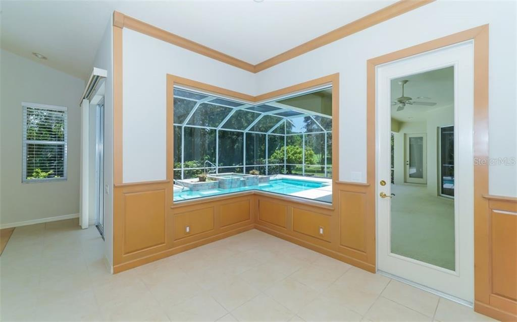 Dinette with pool view and door to lanai/pool - Single Family Home for sale at 462 E Macewen Dr, Osprey, FL 34229 - MLS Number is A4476181