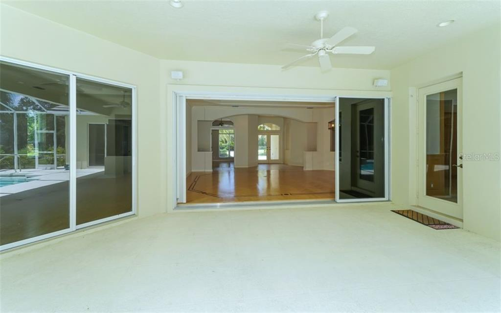 Lanai - Single Family Home for sale at 462 E Macewen Dr, Osprey, FL 34229 - MLS Number is A4476181