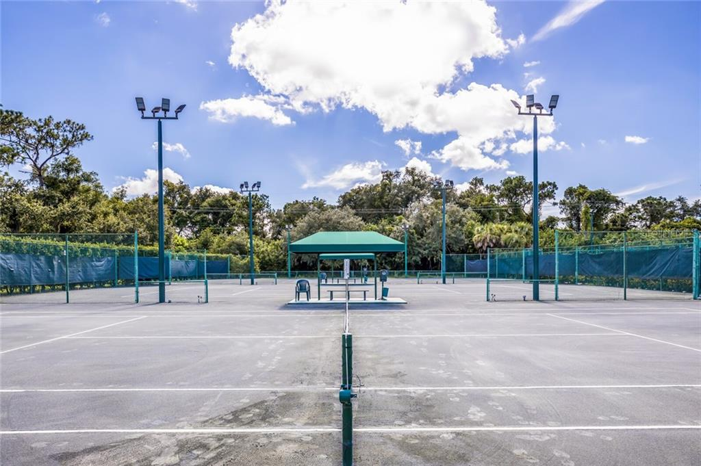 5 Har-Tru tennis courts along with a very active membership offer wonderful tennis playing options. - Single Family Home for sale at 9618 53rd Dr E, Bradenton, FL 34211 - MLS Number is A4477826