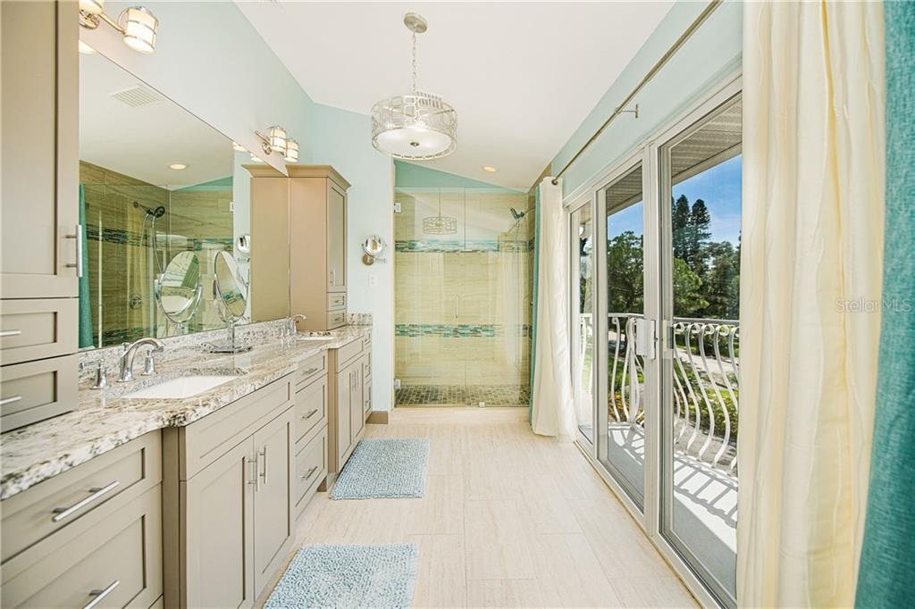Master bath with sliding glass door and balcony. View of Sarasota Bay. - Single Family Home for sale at 7303 Westmoreland Dr, Sarasota, FL 34243 - MLS Number is A4478376