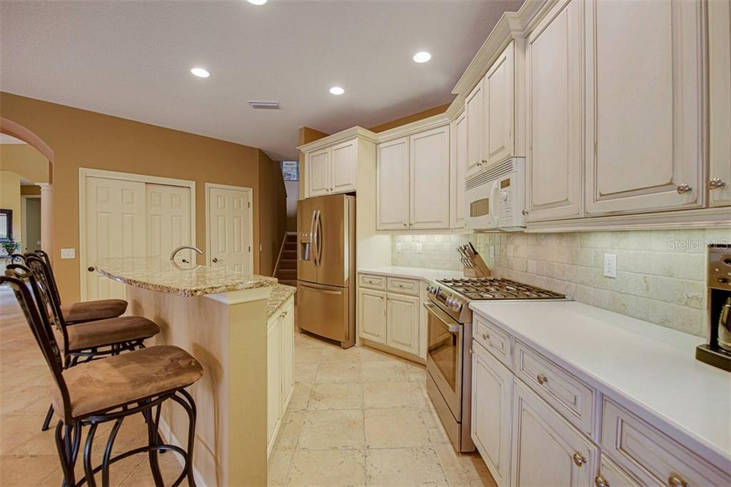 Natural Gas Cooking, breakfast bar, double pantries - Single Family Home for sale at 684 Crane Prairie Way, Osprey, FL 34229 - MLS Number is A4478575