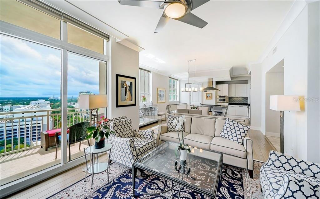 The living room looks across to the dining room and kitchen - Condo for sale at 1350 Main St #1601, Sarasota, FL 34236 - MLS Number is A4478753