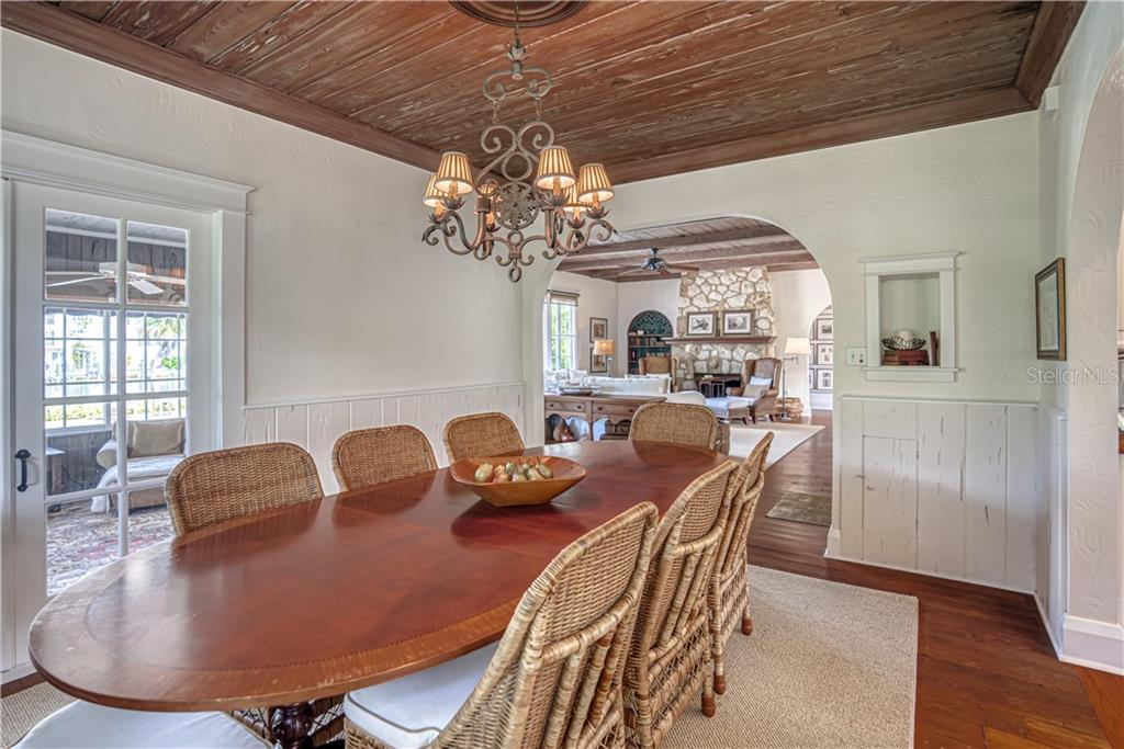 Dining Room is Accentuated w/ Florida Pecky Cypress - Single Family Home for sale at 1595 Bay Point Dr, Sarasota, FL 34236 - MLS Number is A4479218