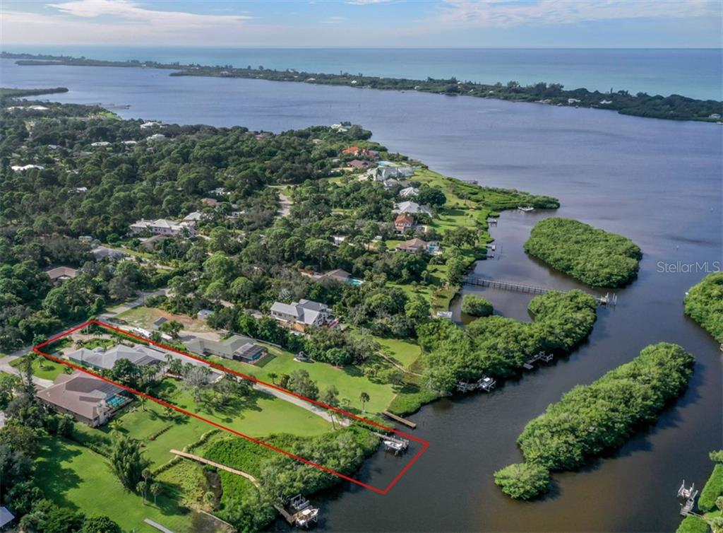 Aerial - Forked Creek leading to Lemon Bay -- Manasota Key and Gulf of Mexico -- Looking South - Single Family Home for sale at 1395 Bayshore Dr, Englewood, FL 34223 - MLS Number is A4480508