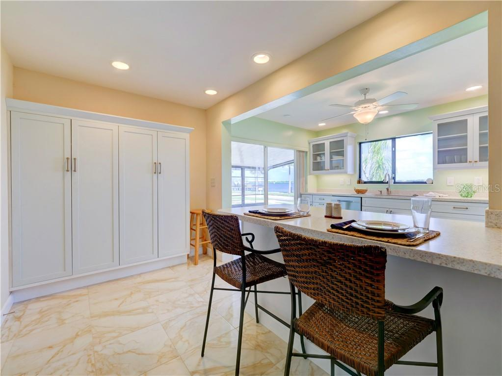 Enjoy breakfast or set up hors d'oeuvres for entertaining at the kitchen bar.  Large pantry provides plenty of storage for dry goods. - Single Family Home for sale at 2408 Riverside Dr E, Bradenton, FL 34208 - MLS Number is A4480609