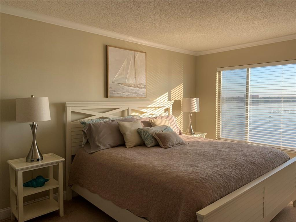 Master Bedroom with Sunrise Bay Views - Condo for sale at 9011 Midnight Pass Rd #328, Sarasota, FL 34242 - MLS Number is A4483601