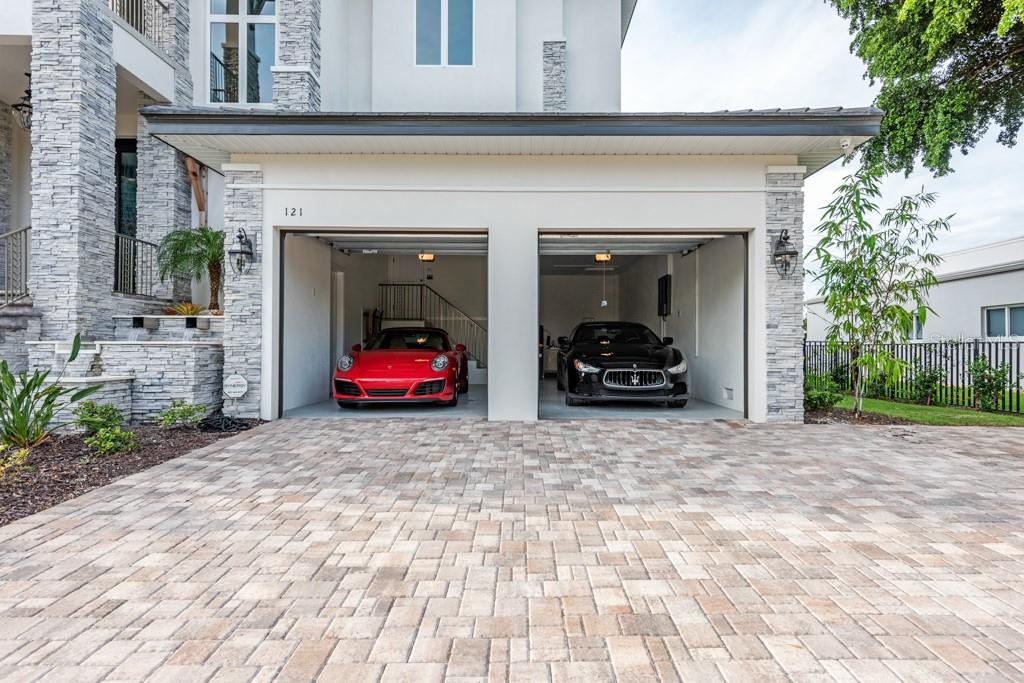 3rd Car Area Is Tandem Style Shown On Right Side Garage Bay. - Single Family Home for sale at 121 Seagull Ln, Sarasota, FL 34236 - MLS Number is A4483951