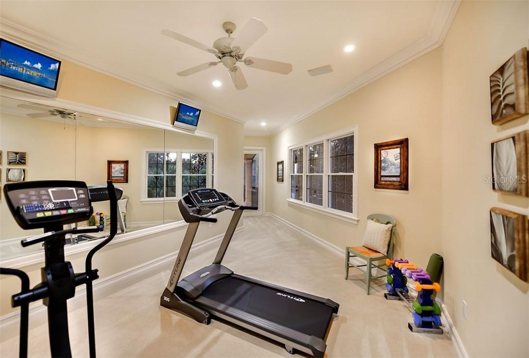 Guest suite - 5 or as we have transitioned it to a fitness room with an amazing French door leading to the upper terrace for some cooling down & stretching. - Single Family Home for sale at 8263 Archers Ct, Sarasota, FL 34240 - MLS Number is A4483993
