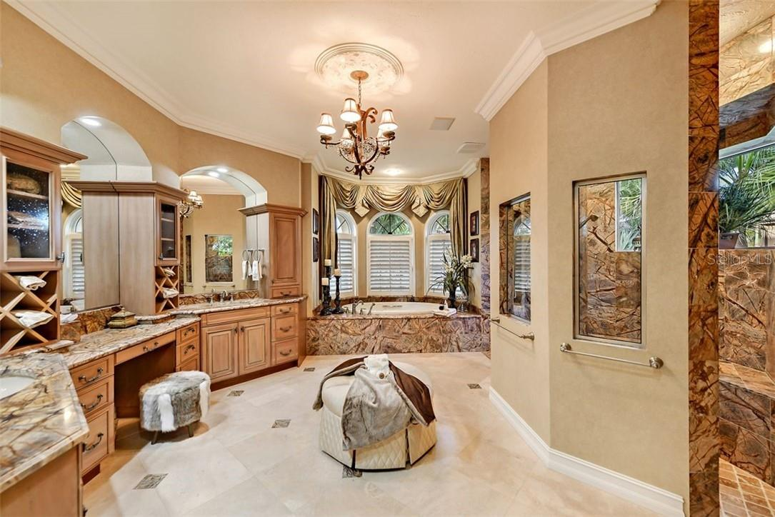 Master retreat bath , beautiful stone, granite cabinetry really highlight this sumptuous bathroom, a walk in double door shower with many shower heads to wash your cares away. - Single Family Home for sale at 8263 Archers Ct, Sarasota, FL 34240 - MLS Number is A4483993