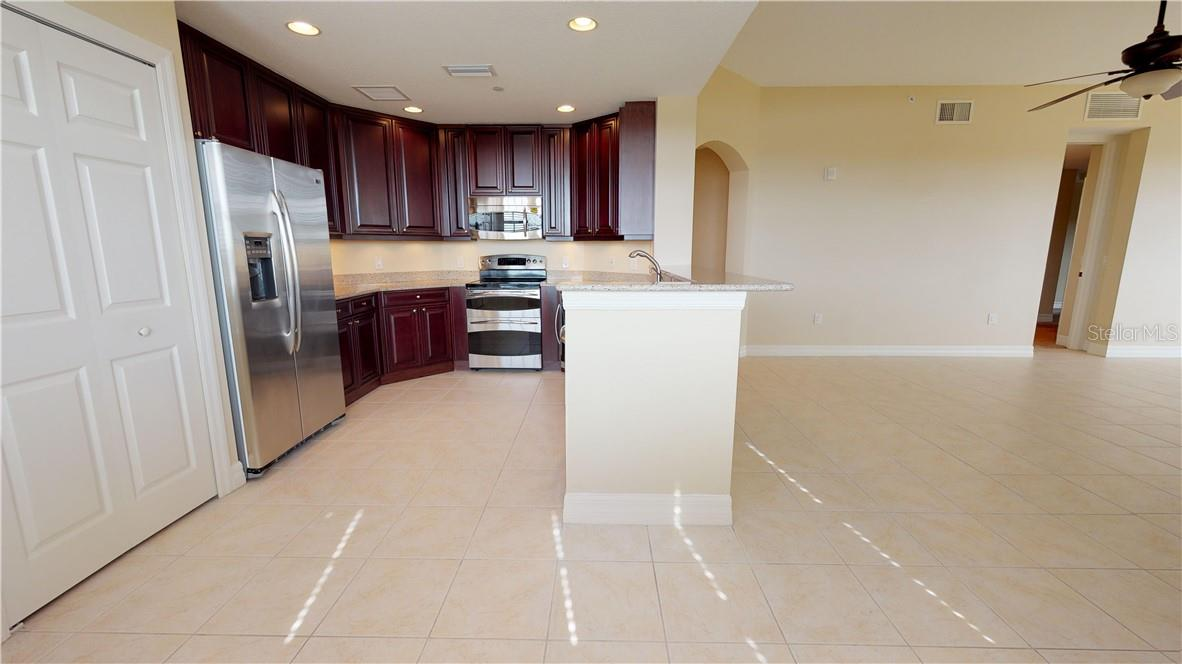 Open kitchen into dining area - Condo for sale at 5591 Cannes Cir #506, Sarasota, FL 34231 - MLS Number is A4484243
