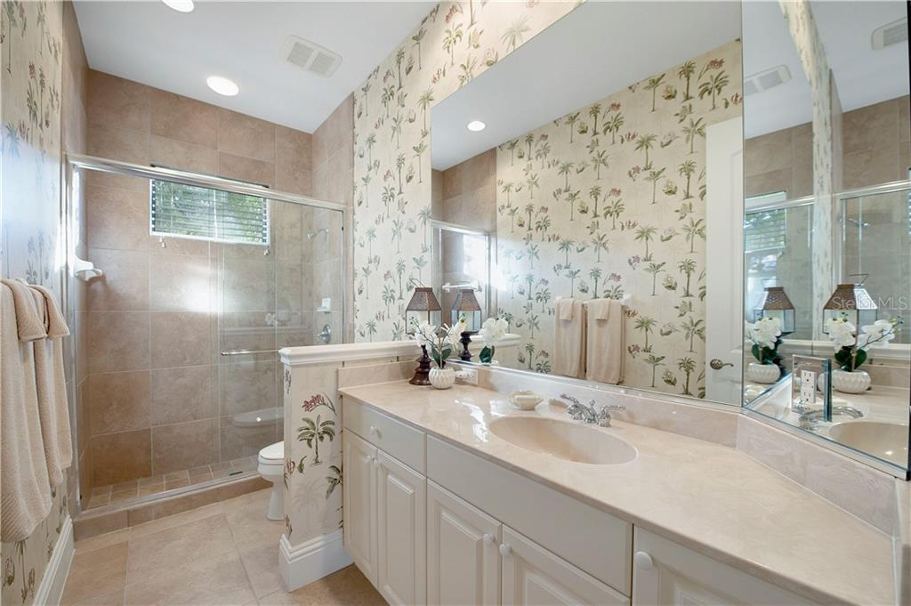 3rd full bath with glass shower; between bedroom 4 and the office/study - Single Family Home for sale at 13223 Palmers Creek Ter, Lakewood Ranch, FL 34202 - MLS Number is A4484826