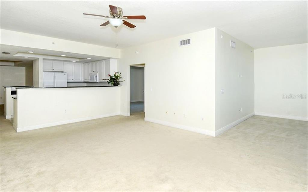 Kitchen looking toward the dining room - Condo for sale at 800 N Tamiami Trl #1007, Sarasota, FL 34236 - MLS Number is A4485565