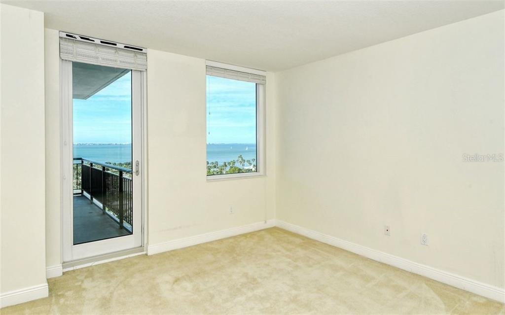 Walk in closet - Condo for sale at 800 N Tamiami Trl #1007, Sarasota, FL 34236 - MLS Number is A4485565