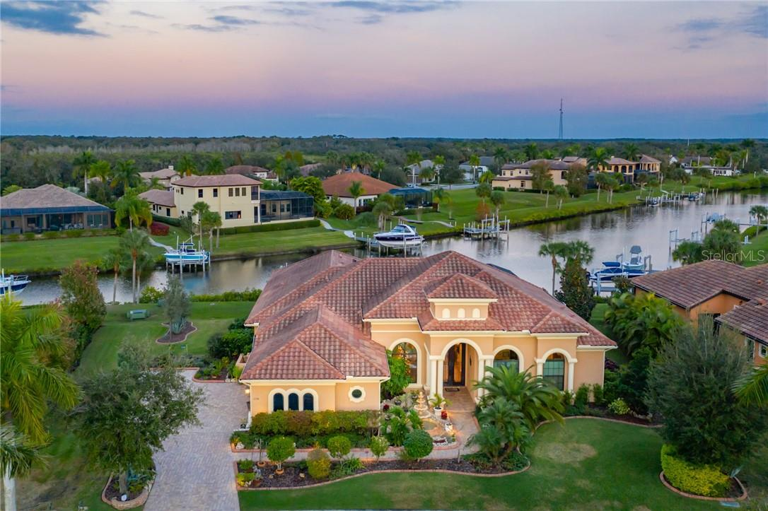 Large family estate in the Nautical & Golf Community of The Islands on the Manatee River - Single Family Home for sale at 11720 Rive Isle Run, Parrish, FL 34219 - MLS Number is A4486302
