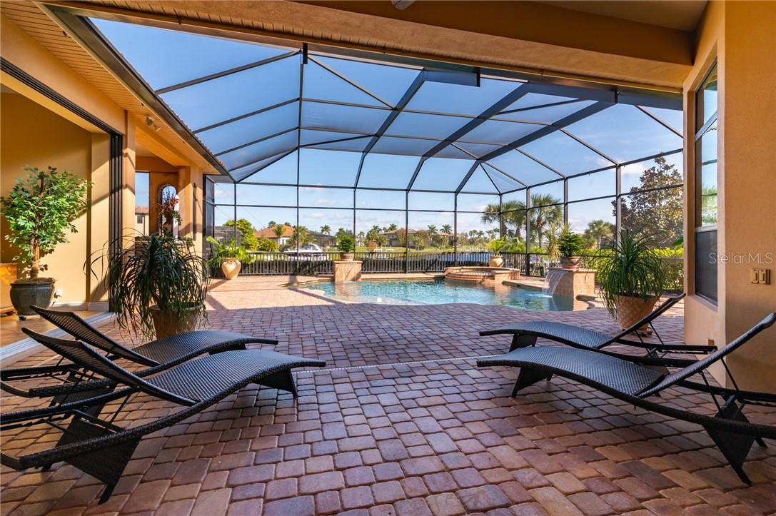 The view of the Lanai and Pool from the Formal Living Room / Dining Room. - Single Family Home for sale at 11720 Rive Isle Run, Parrish, FL 34219 - MLS Number is A4486302