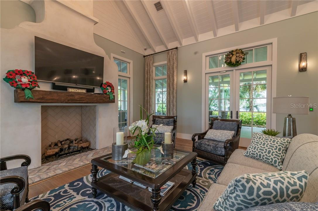 The indoor fireplace and seating area in the River Lodge. - Single Family Home for sale at 11720 Rive Isle Run, Parrish, FL 34219 - MLS Number is A4486302