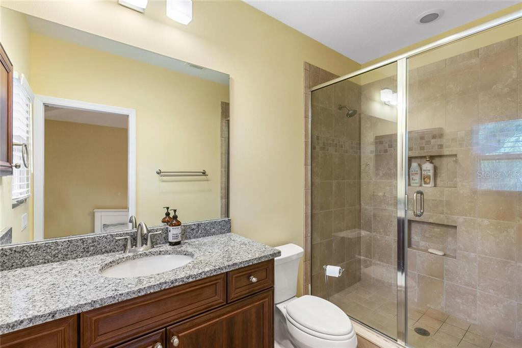 En-suite guest bath off guest bedroom 2. - Single Family Home for sale at 1145 Horizon View Dr, Sarasota, FL 34242 - MLS Number is A4486759