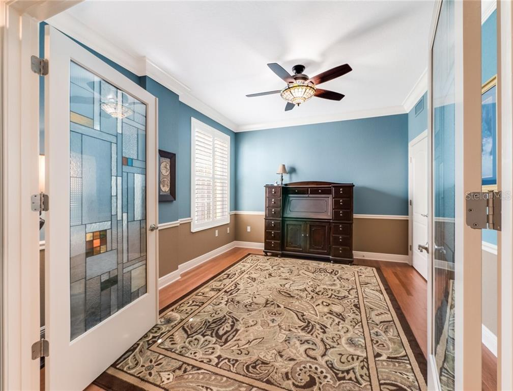 Gorgeous custom doors leading into the office/bedroom. - Condo for sale at 14021 Bellagio Way #407, Osprey, FL 34229 - MLS Number is A4487552