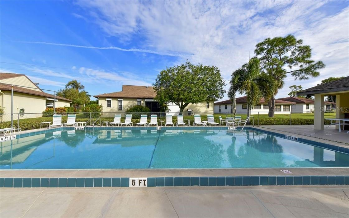 Community pool is located nearby. - Villa for sale at 3314 Vivienda Blvd, Bradenton, FL 34207 - MLS Number is A4488348