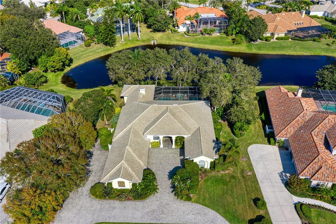 You can look out at the lake, but the neighbors can't see in - Single Family Home for sale at 7879 Estancia Way, Sarasota, FL 34238 - MLS Number is A4490318